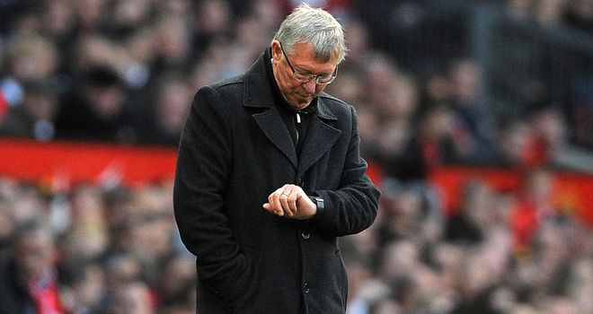 Sir Alex Ferguson: Manchester United manager checks his watch during the defeat by Tottenham