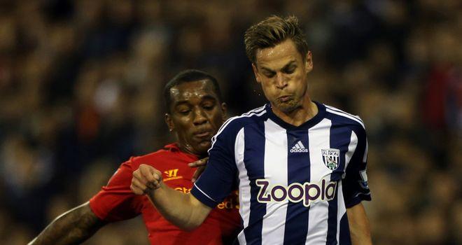 Markus Rosenberg battles with Liverpool's Andre Wisdom