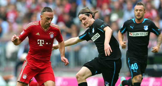Franck Ribery is challenged by Sebastian Rudy