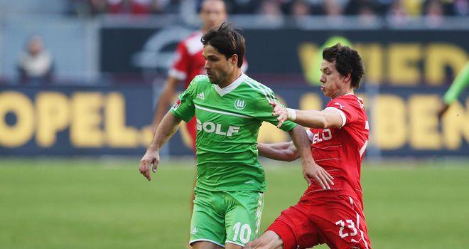 Diego is tackled by Robbie Kruse