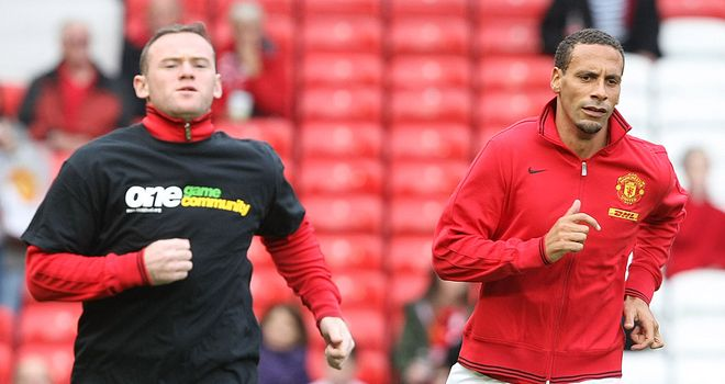 Rio Ferdinand (right): Says Wayne Rooney should stay at Old Trafford