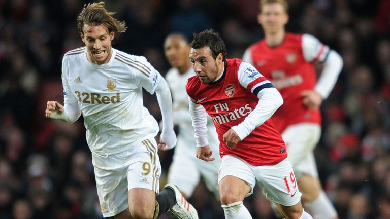 Michu (l): Tracks Arsenal's Cazorla