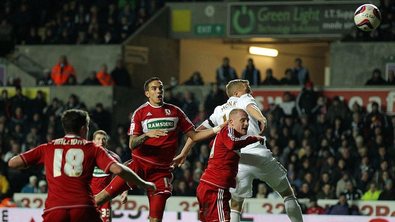 Own goal: Seb Hines is consoled by Richie Smallwood after his own goal gave Swansea victory