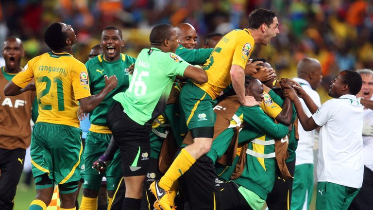 May Mahlungu: Is mobbed after scoring against Morocco
