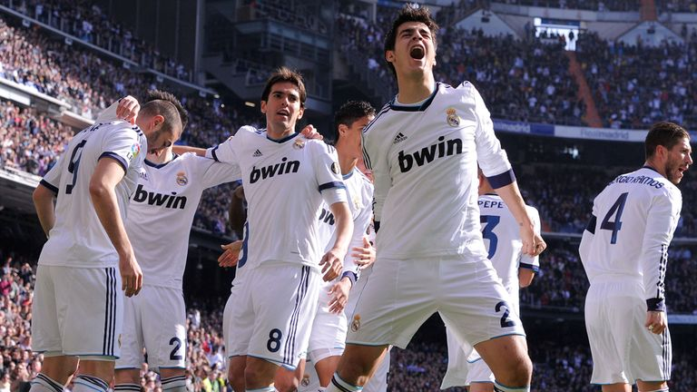 Karim Benzema is mobbed after scoring the opener in Saturday's El Clasico