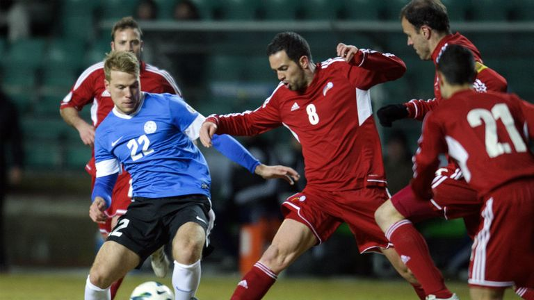 Andorra's Marcio Vieria battles for the ball with Henri Anier