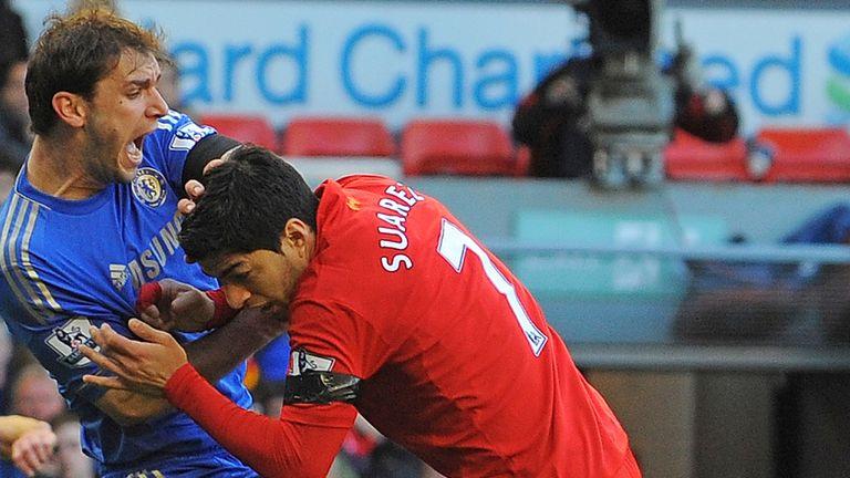 Luis Suarez attacks Branislav Ivanovic during Liverpool's 2-2 draw with Chelsea