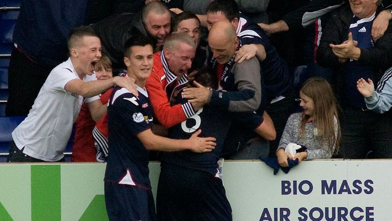 Richard Brittain celebrates his winner with the Ross County fans