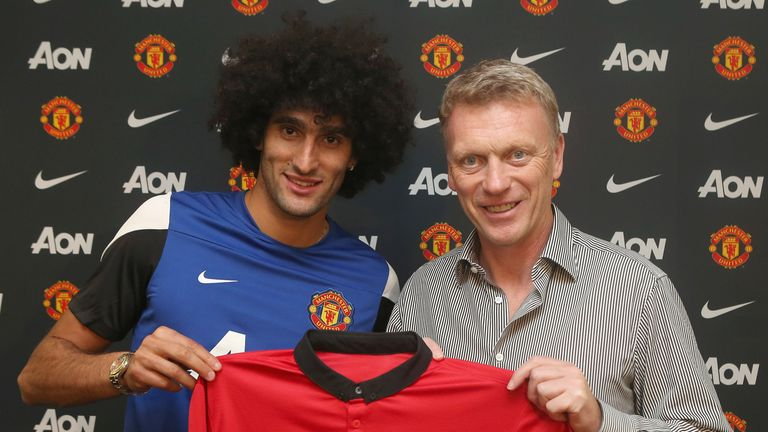 Marouane Fellaini poses David Moyes on September 2, 2013