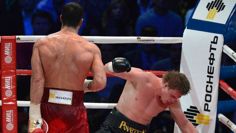 Alexander Povetkin (right) staggers back to the canvas during the unification bout