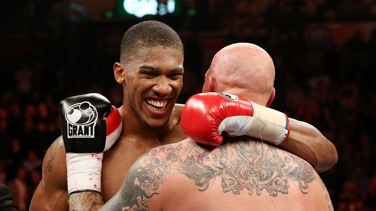 Anthony Joshua shares a word with Paul Butlin after the former's second-round victory