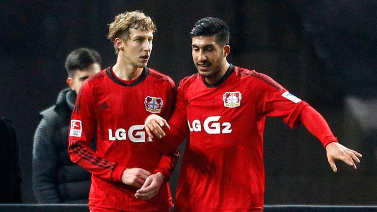 Stefan Kiessling (left) of Leverkusen celebrates with Emre Can
