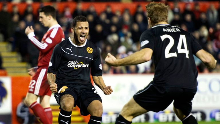 Lionel Ainsworth celebrates after scoring the goal which took Motherwell second in the table