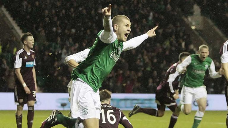 James Collins: Turns away after opening the scoring in the Edinburgh derby