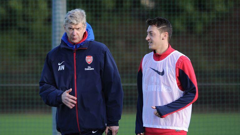 Image result for Mesut Ozil with Wenger