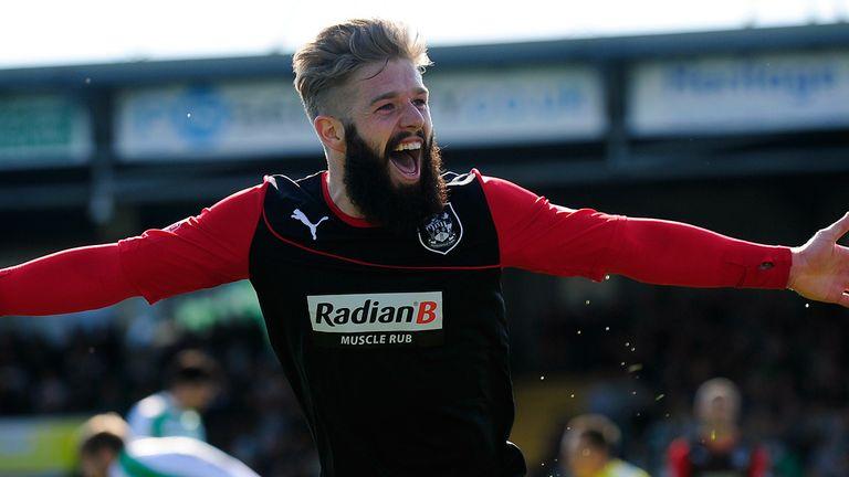 Adam Clayton celebrates Huddersfield's winner