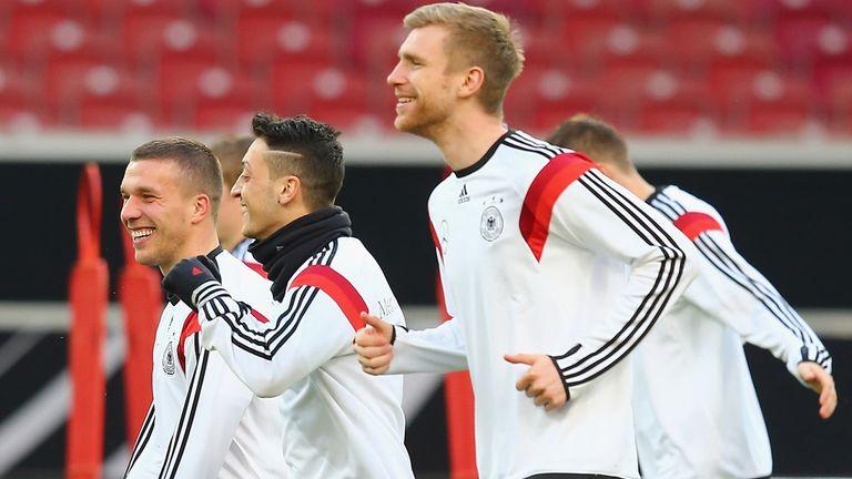 Lukas Podolski (l): Feels Mesut Ozil (c) can only get better