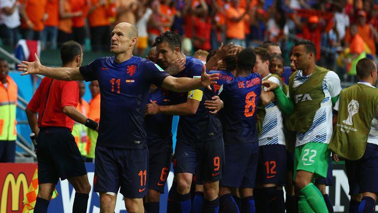 Arjen Robben scored two of Holland's five goals against holder Spain