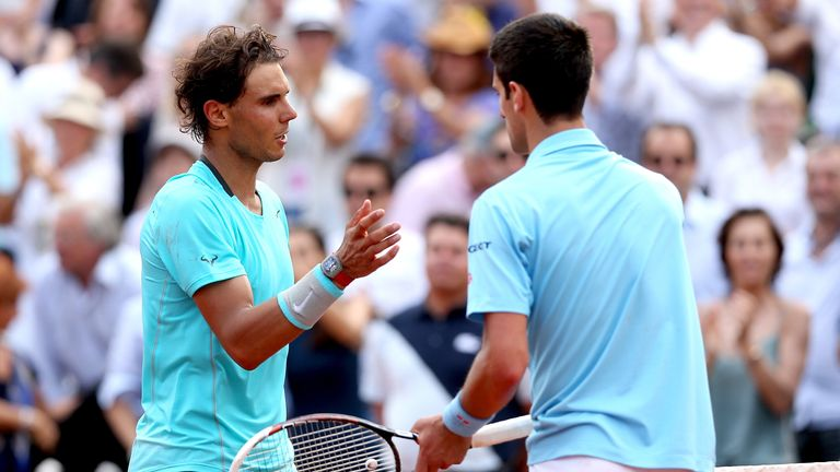 Nadal and Djokovic shake hands at the net