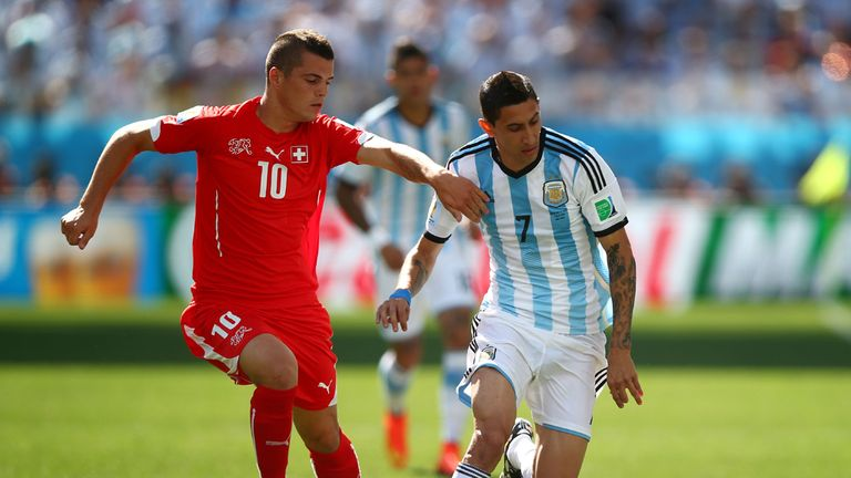Xhaka in action at the World Cup against Argentina's Angel Di Maria