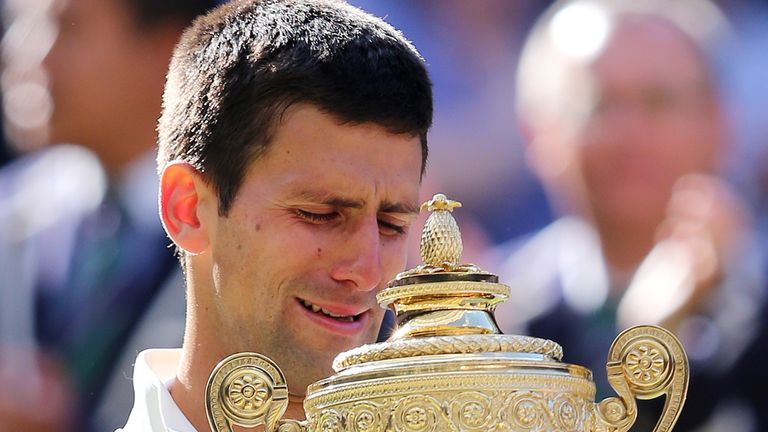 Novak Djokovic weeps whilst holding the Wimbledon trophy