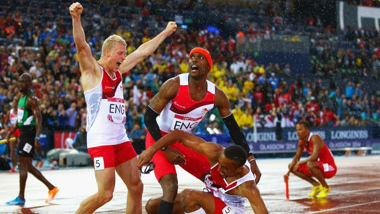 Conrad Williams, Matthew Hudson-Smith and Daniel Awde of England celebrate winning gold in the 4x400 metres