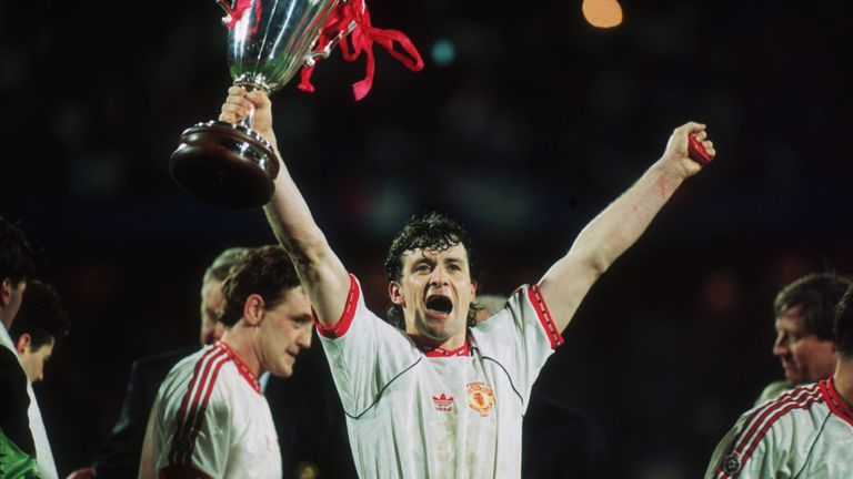 Mark Hughes of Manchester United raises the European Cup Winners' Cup in 1991