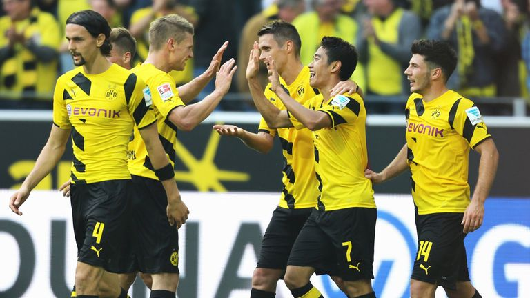 Shinji Kagawa celebrates after scoring for Borussia Dortmund