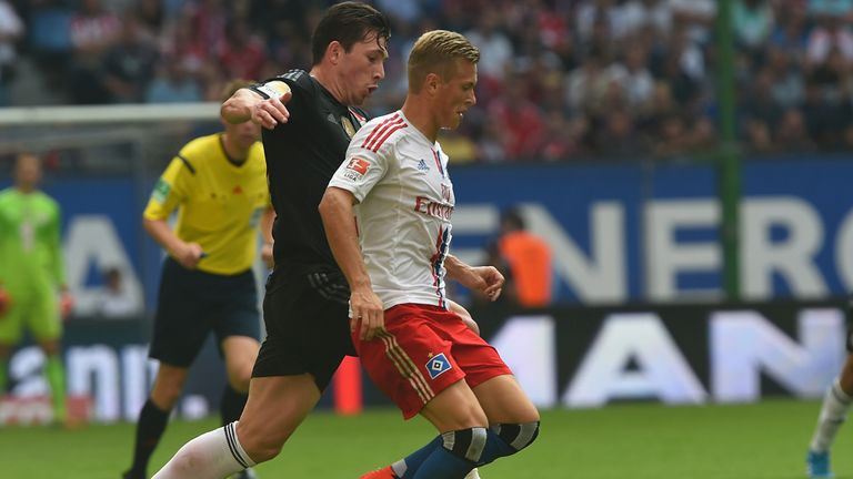 Pierre Emile Hojbjerg of Bayern challenges for the ball with Matthais Ostrzolek