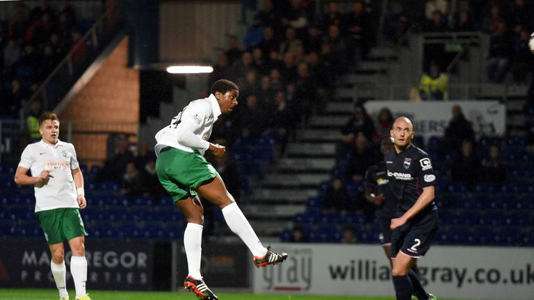 Hibernian's Dominique Molonga heads his side into the lead against Ross County.