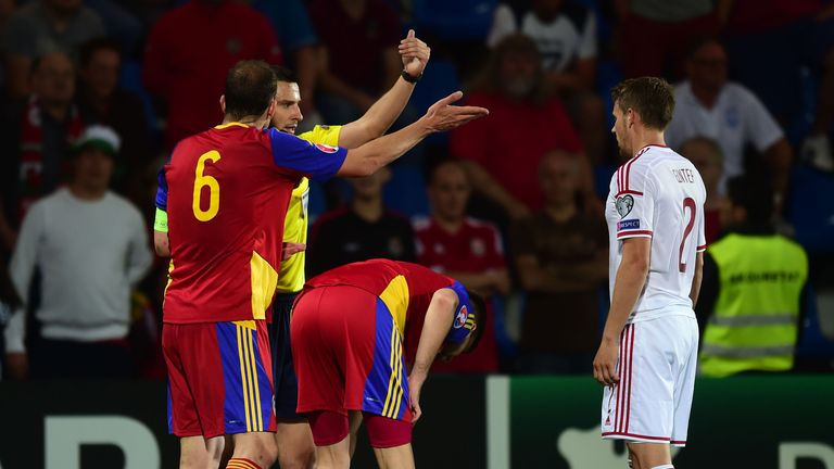 Wales' Aaron Ramsey on the floor after injuring his ankle against Andorra