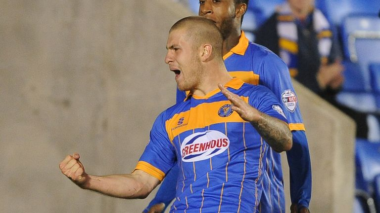 James Collins: Celebrates after scoring for Shrewsbury against Norwich