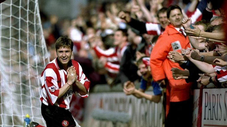 Close to the fans: Marian Pahars of Southampton celebrates at the Dell
