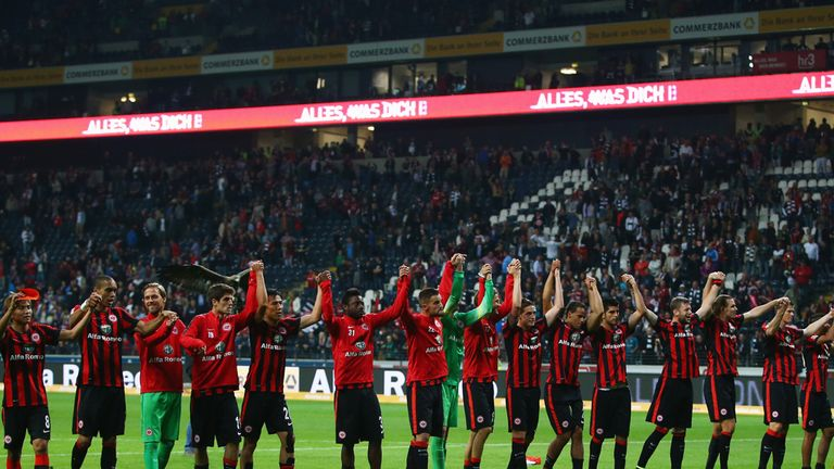 Eintracht Frankfurt players celebrate victory over Cologne