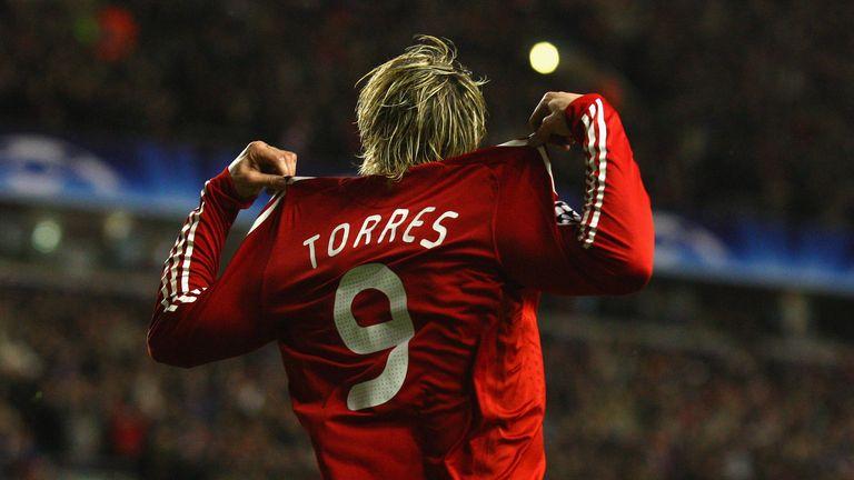 Fernando Torres celebrates opening the scoring against Real