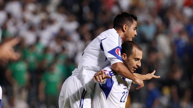Omer Damari (r:) Celebrates scoring against Cyprus