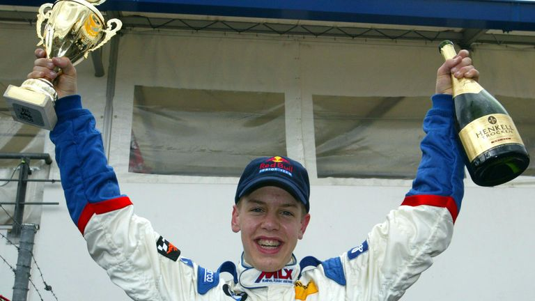 Sebastian Vettel sports the Red Bull logos back in 2003