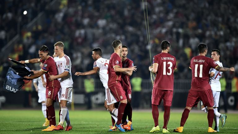 Serbia and Albania players scuffle over the flag