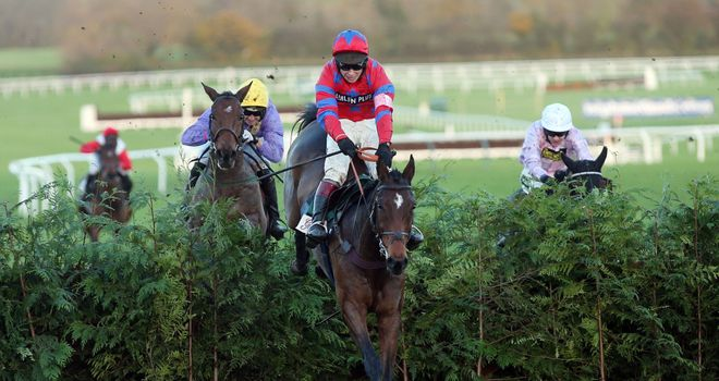 Balthazar King, ridden by Richard Johnson, jumps the last on the way to victory in the Glenfarclas Cross Country Chase.
