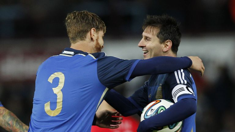 Lionel Messi: Celebrates with fellow scorer Christian Ansaldi