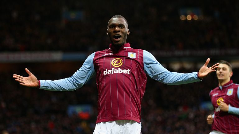 Christian Benteke celebrates his goal in the first half at Villa Park