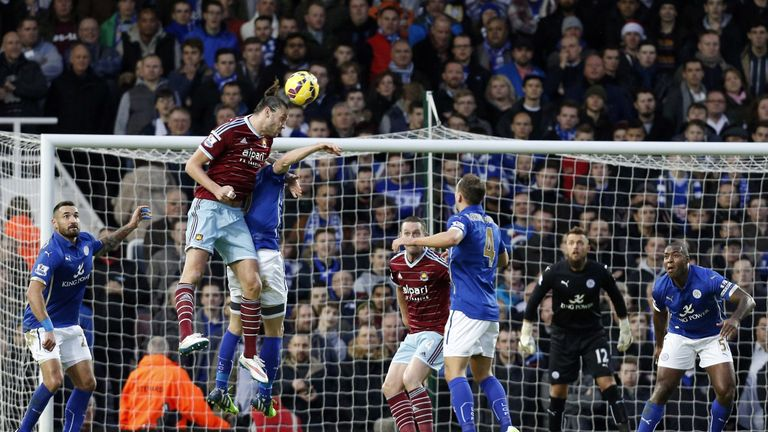 Andy Carroll climbs above the Leicester defence to win a header