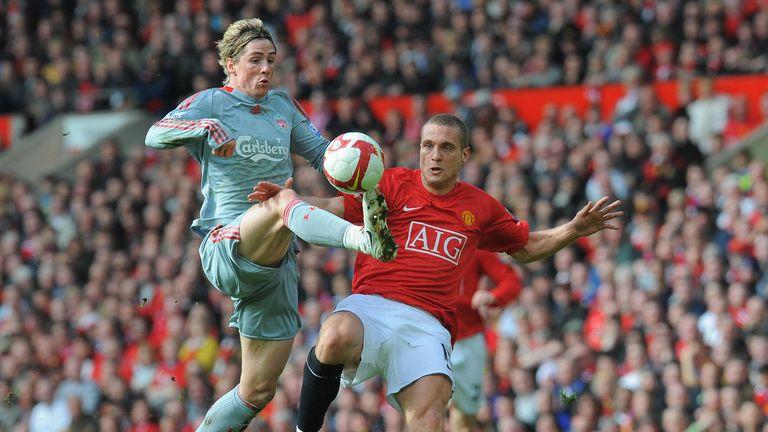 Liverpool  forward Fernando Torres beats United defender Nemanja Vidic to equalise in 2006