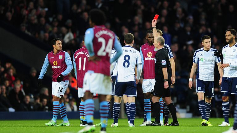 Mike Dean shows Kieran Richardson a straight red card for his tackle on Stephane Sessegnon.