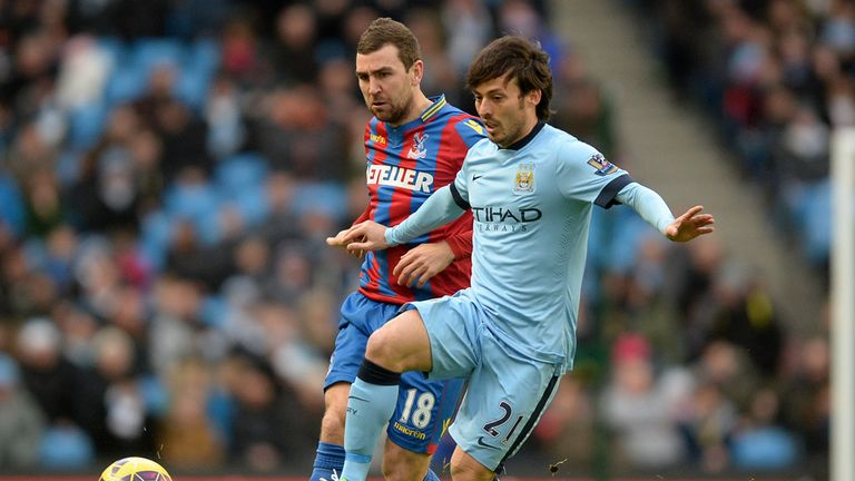 Manchester City's David Silva and Crystal Palace's James McArthur battle for the ball
