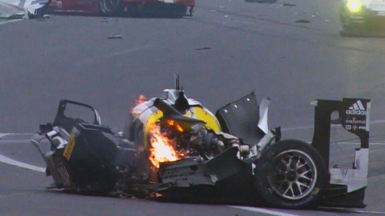 Mark Webber's Porsche catches fire after crashing at high speed