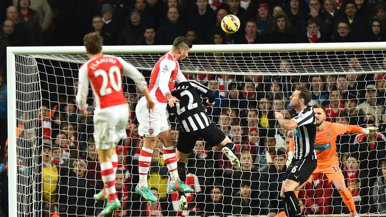 Olivier Giroud rises highest to score the opening goal.