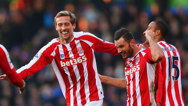 Peter Crouch celebrates with Erik Pieters