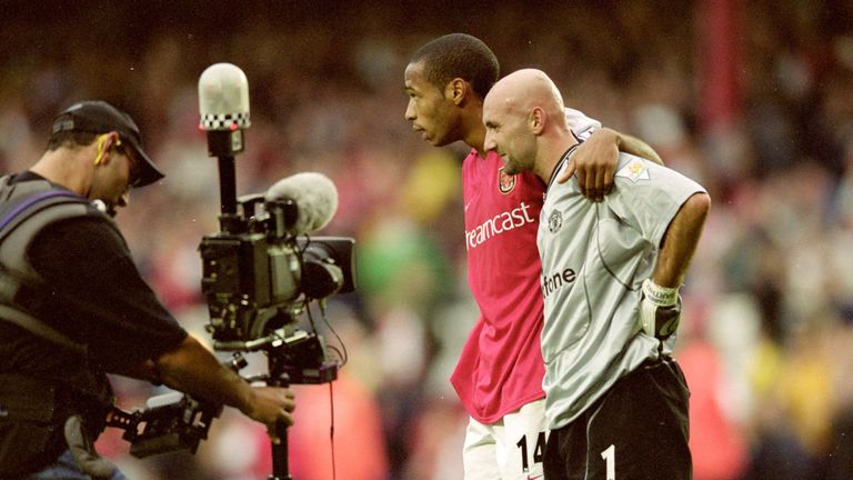 Henry consoles Fabien Barthez after beating him from distance at Highbury in 2000