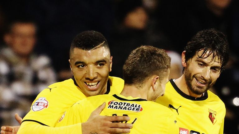 Troy Deeney: Celebrates with his Watford team-mates after scoring at Fulham